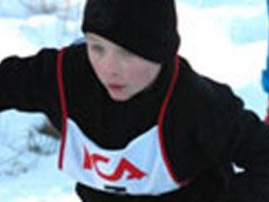 Young skier in skitrac.