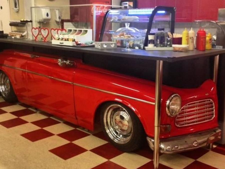 Glas counter built on top of a red Amazon car.
