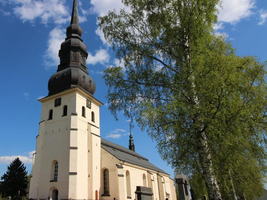 Stora Tuna Church, white with high steeple.