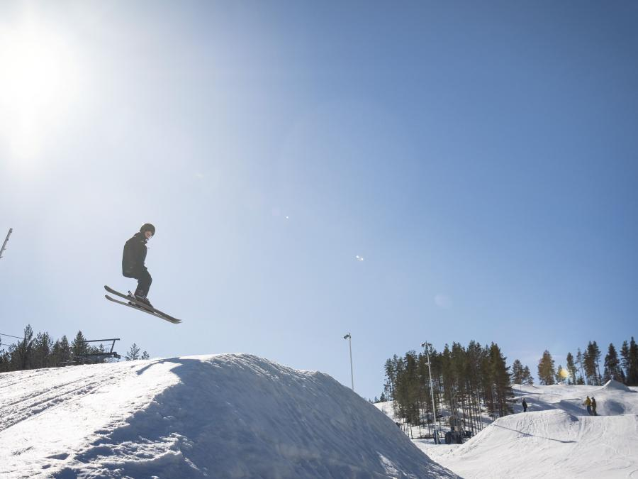 One person jumping in the snowpark.