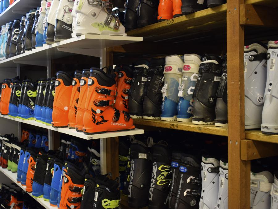 Ski boots on a shelf.