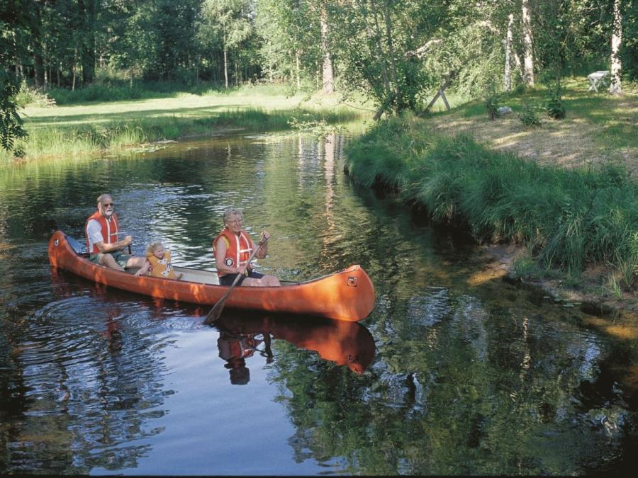 Adults and children in a canoe.